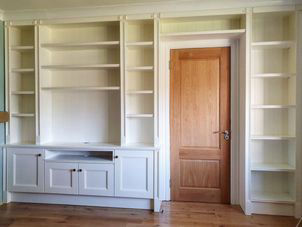 Full wall spraypainted book case in ivory